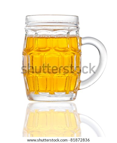 Glass of beer isolated on a white background with reflections