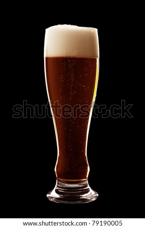 glass of beer isolated over a black background - stock photo
