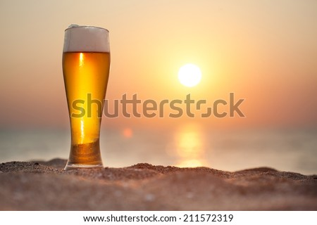 Glass of beer on a sunset   - stock photo