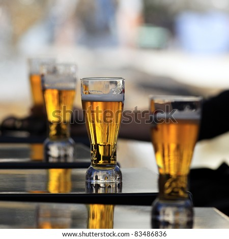 glass of beer on a table in a restaurant - stock photo