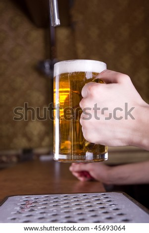 Glass of beer on pub - stock photo