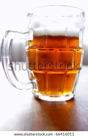 Glass of beer on table - stock photo