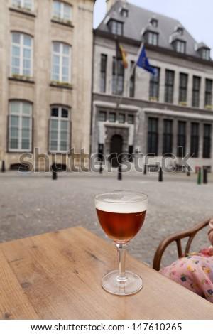 Glass of beer on table in street restaurant, Antwerpen, Belgium  - stock photo