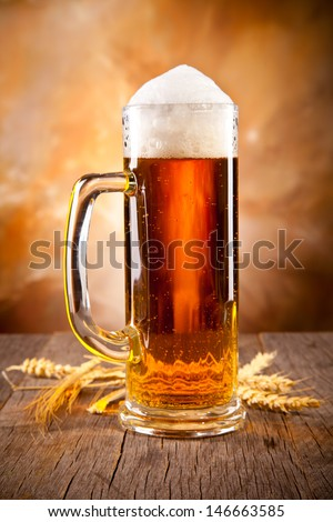 Glass of beer on wood