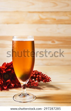 Glass of beer on wood background - stock photo