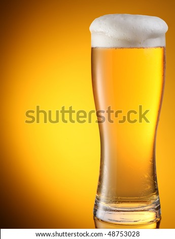 Glass of Beer on Yellow - stock photo