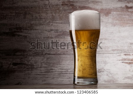 glass of beer over grunge background