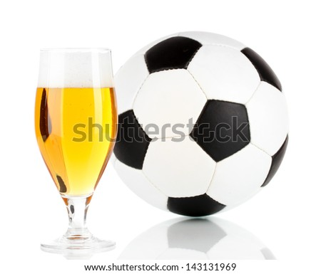 Glass of beer  with ball isolated on white - stock photo