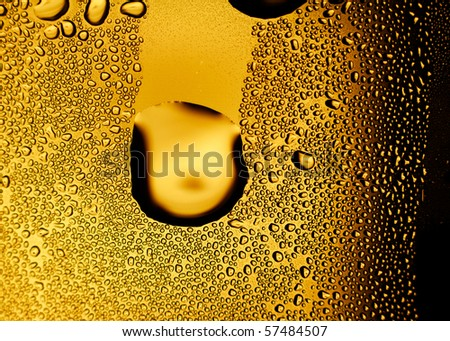 Glass of beer with dew bubbles. Background for design works. - stock photo