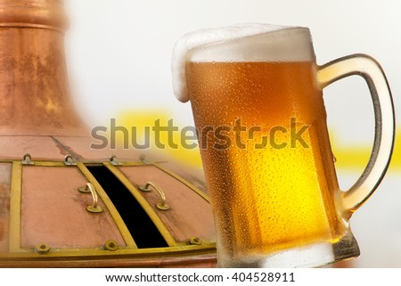 glass of beer with drops of water in the brewery