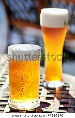 Glass of beer with froth - stock photo
