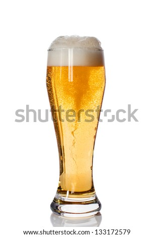 Glass of beer with high foam isolated on a white background - stock photo