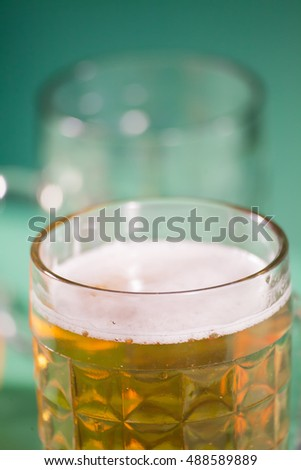 glass of beer with reflection in studio