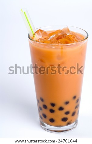 Glass of black tea with cream and tapioca - stock photo