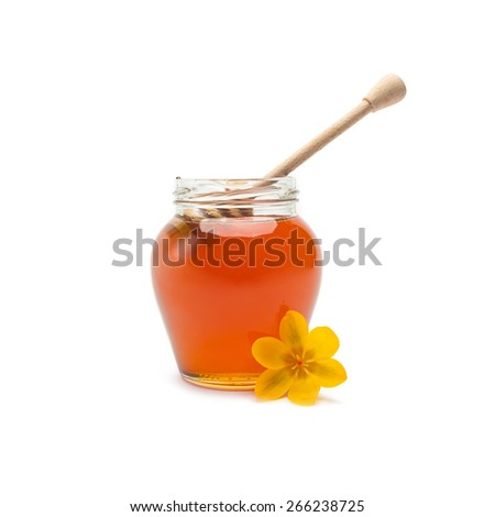 glass of blossom honey with wooden drizzler isolated on white background - stock photo