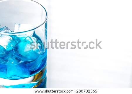 Glass of blue curacao cocktail - stock photo