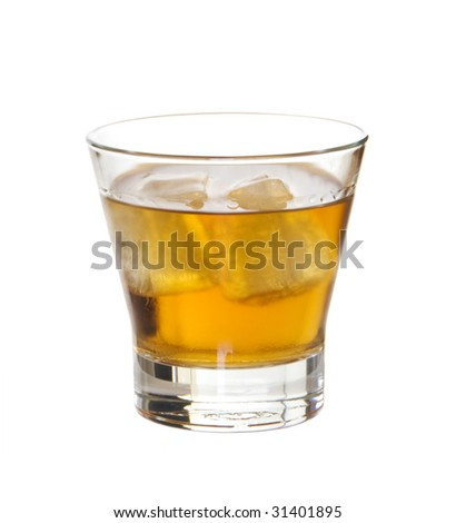 Glass of brandy on ice isolated