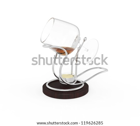 Glass of brandy on stand with candle isolated on white background