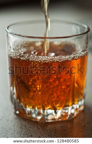 glass of brandy on table