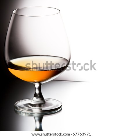 Glass of brandy over white background - stock photo