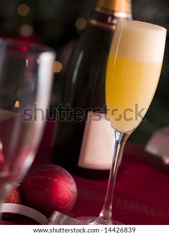 Glass of Bucks Fizz - stock photo