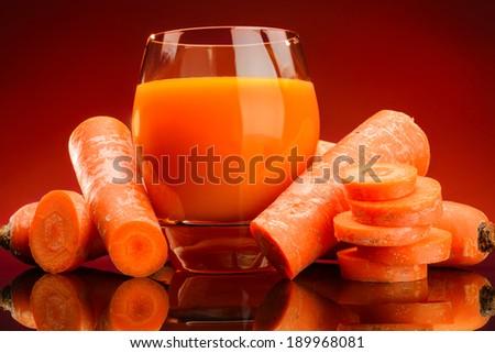 Glass of carrot juice - stock photo