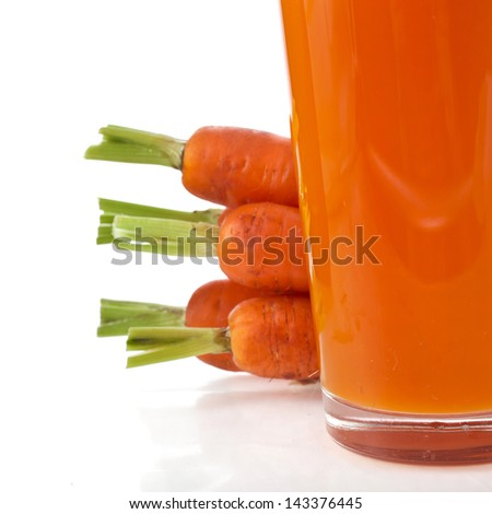 glass of carrot juice and fresh carrots isolated on white background