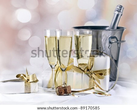 Glass of champagne and gift - stock photo