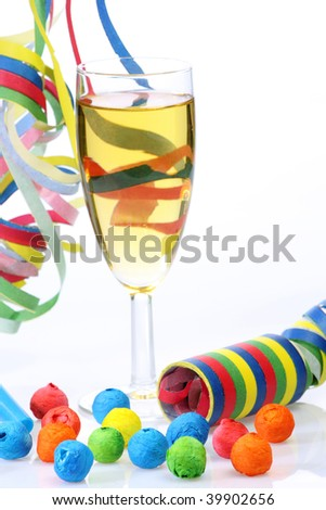 Glass of champagne and streamer on bright background