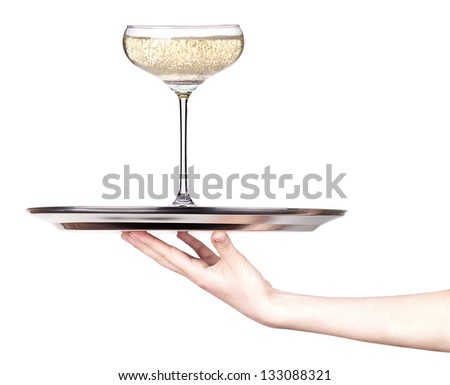 glass of champagne isolated on a silver tray white background - stock photo