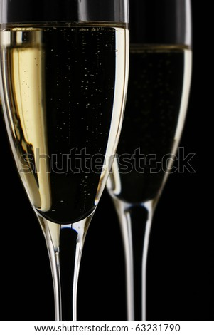 Glass of Champagne isolated on black background - stock photo