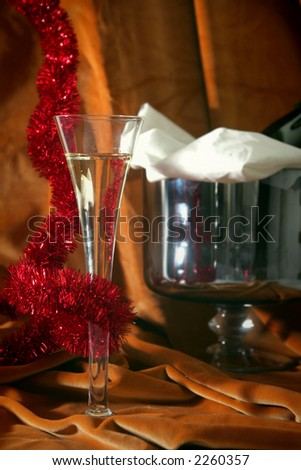 Glass of champagne on a golden-orange background - stock photo