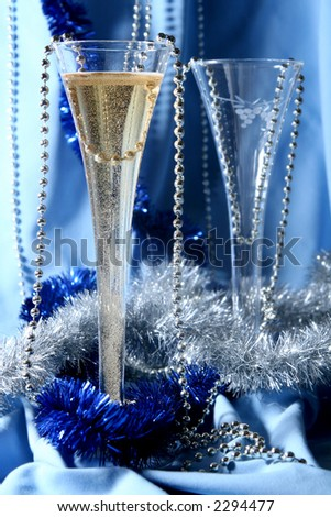 Glass of champagne on a silver-blue background - stock photo
