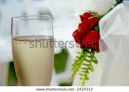 Glass of champagne on a wedding day - stock photo
