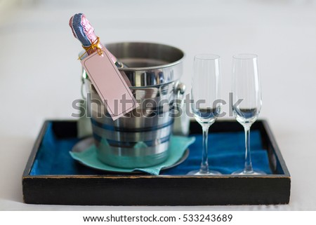 Glass of champagne on table set for a wedding