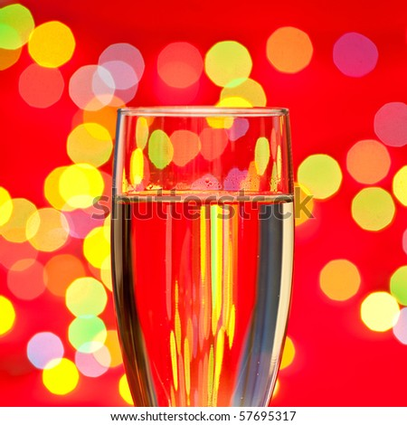 Glass of champagne with blured lights in background, very shallow DOF - stock photo