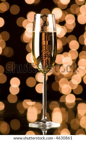 glass of champagne with Christmas lights - stock photo
