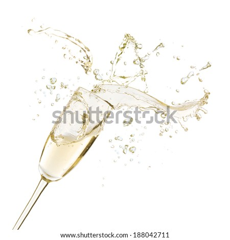 Glass of champagne with splash, isolated on white - stock photo