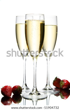 Glass of champagne with strawberry - stock photo