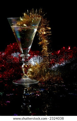 Glass of chapagne on a black background - stock photo