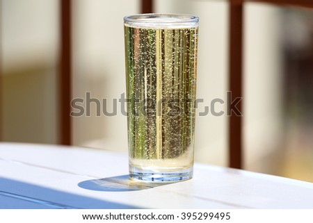 Glass of cider in a glass on the table - stock photo