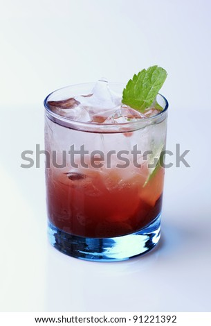 Glass of cocktail drink with ice - stock photo