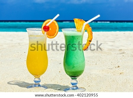 Glass of cocktail is on sandy coral  beach, Maldives, The Indian Ocean - stock photo