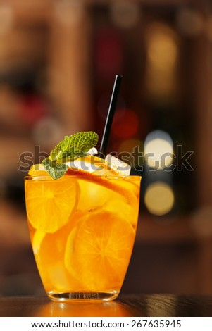 Glass of cocktail on bar background - stock photo