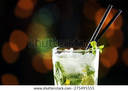 Glass of cocktails on bar background - stock photo