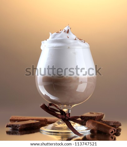 glass of coffee cocktail on brown background - stock photo