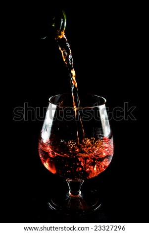 Glass of cognac on a black background - stock photo