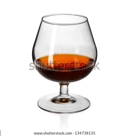 Glass of cognac on on white background - stock photo