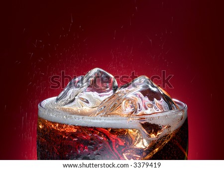 Glass of cola drink with ice closeup - stock photo
