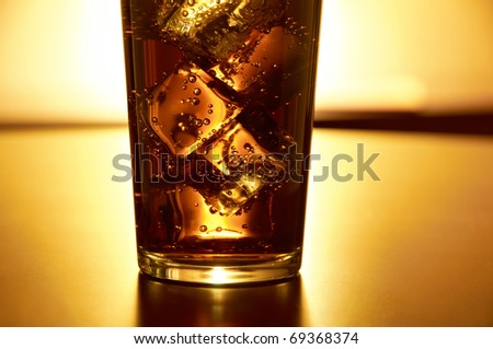 Glass of cola with ice - stock photo